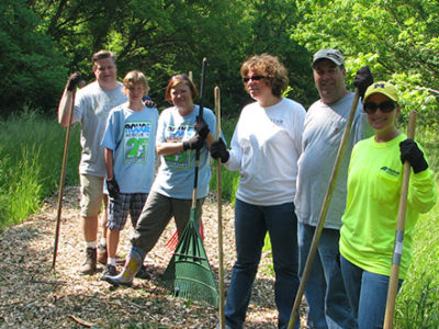 Volunteers cleaning the trail at Eliza Howell Park