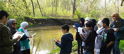 Rouge Education Project - Adults teaching children by the Rouge River