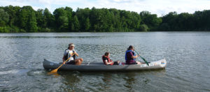 Three people canoeing on the Rouge River
