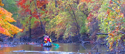 Paddling on the river in fall