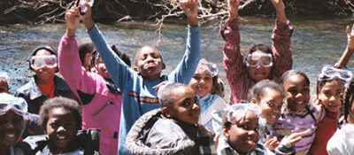 Children cheering beside the Rouge River