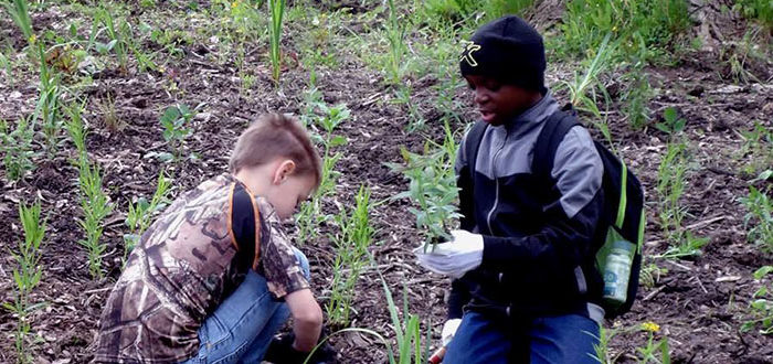 Kids planting for the sake of the Rouge River's restoration
