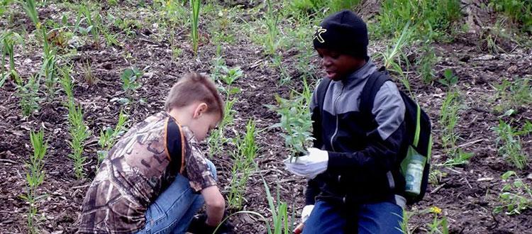 Kids planting for the sake of the Rouge River's restoration