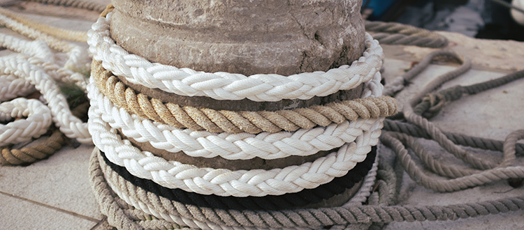 Ropes around a dock pilon