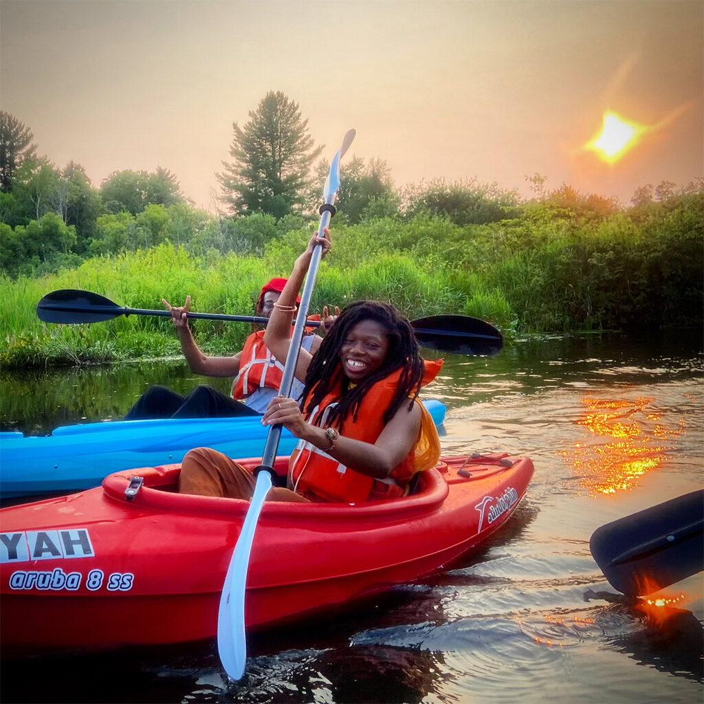 Browns & Blacks In Kayaks-2021 happy kayakers in the water