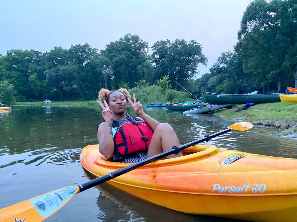 Browns & Blacks In Kayaks-2021 woman giving the double-victory pose
