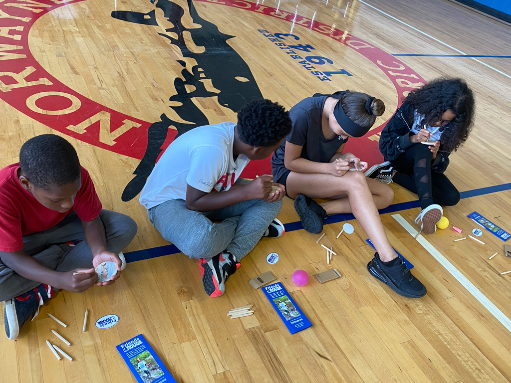 Jeffersen-Barnes Dry Dock Pop Up several students working on their badge