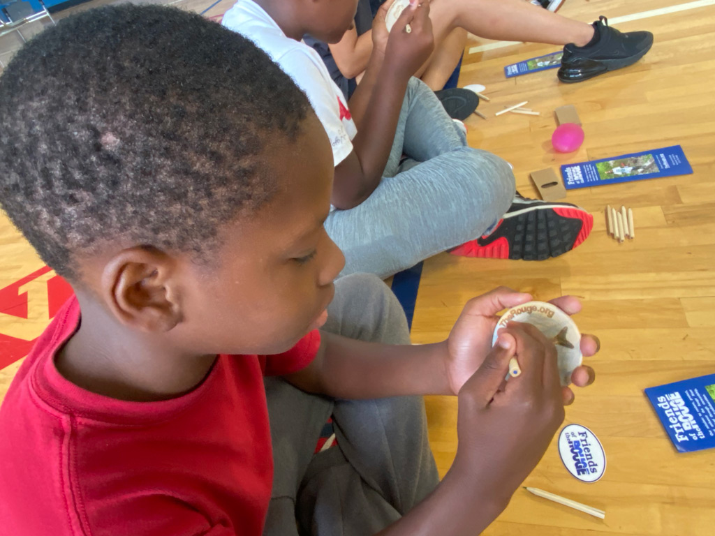 Jeffersen-Barnes Dry Dock Pop Up student working on his badge