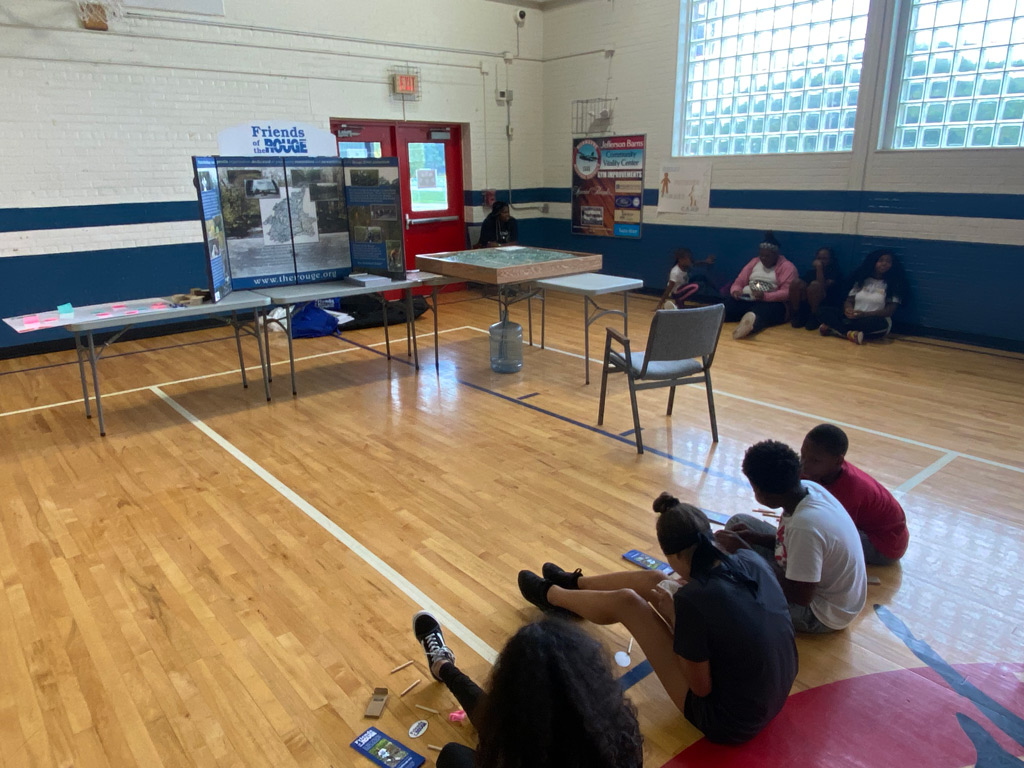 Jeffersen-Barnes Dry Dock Pop Up students in the gym with Friends of the Rouge educational materials