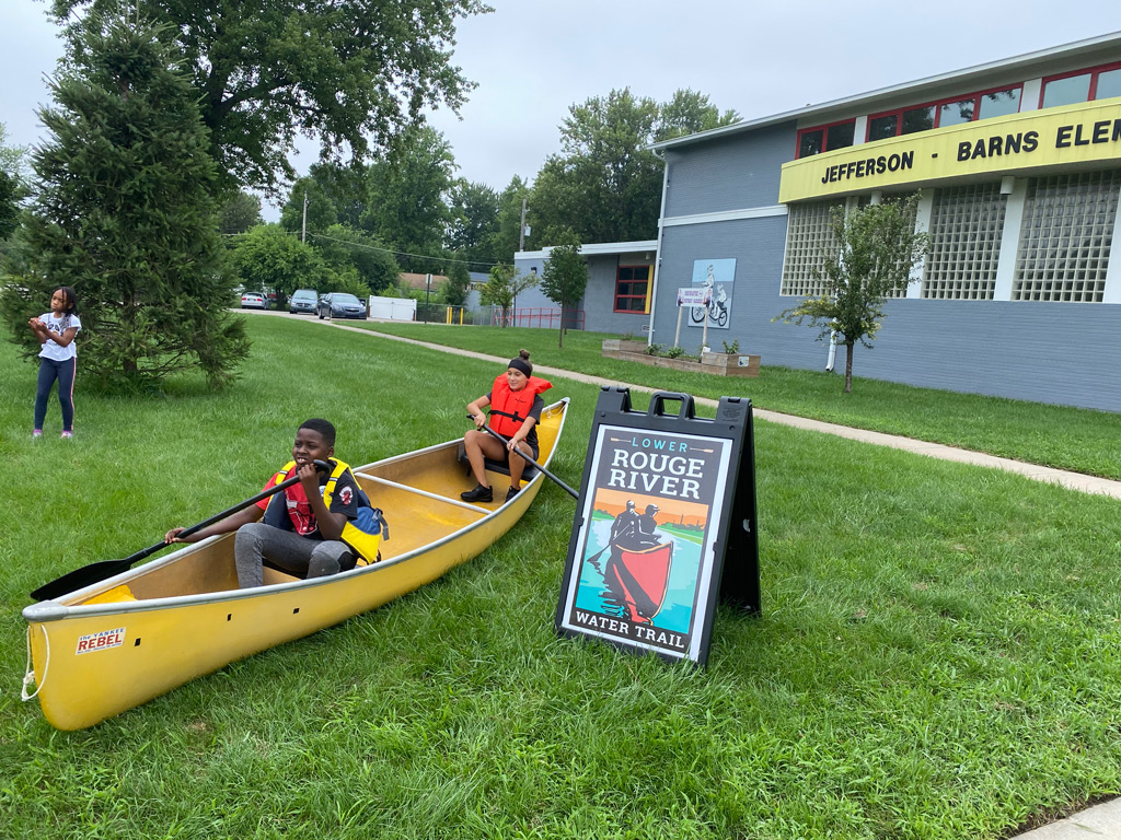 Jeffersen-Barnes Dry Dock Pop Up two students in the canoe with the paddles