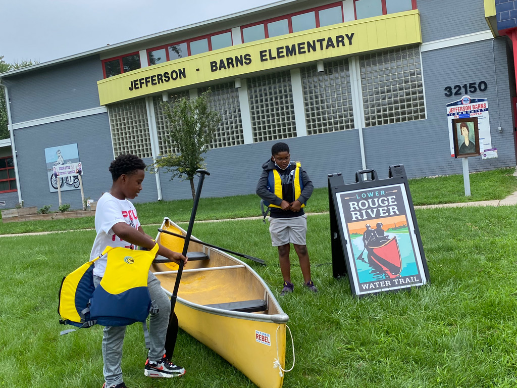Jeffersen-Barnes Dry Dock Pop Up two students getting ready with life jackets