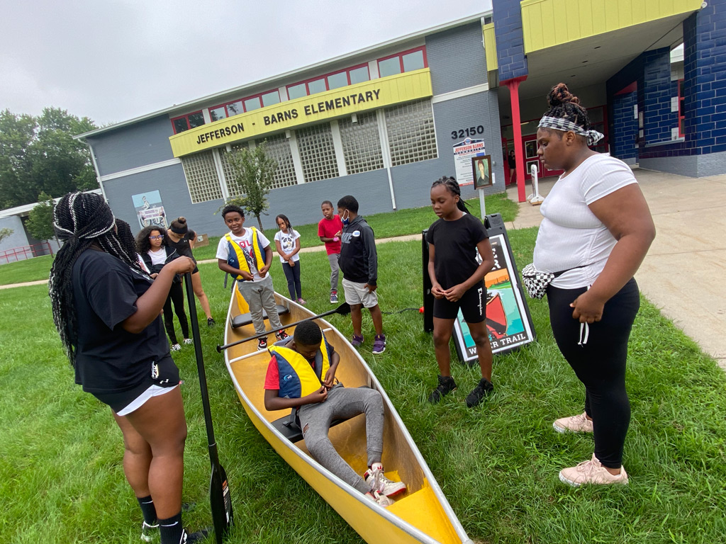 Jeffersen-Barnes Dry Dock Pop Up on the lawn with the canoe learning about it