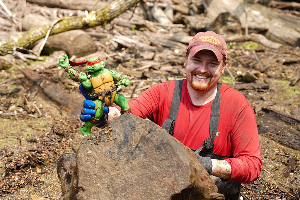 Log Jam Day 072421 volunteer showing a Ninja Turtle found in the log jam debris